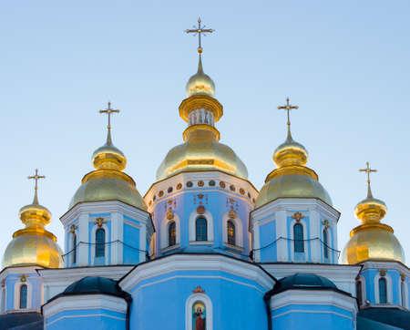 setting  sun: Domes and crosses of St. Michaels Golden-Domed Monastery in the setting sun. Kiev, Ukraine