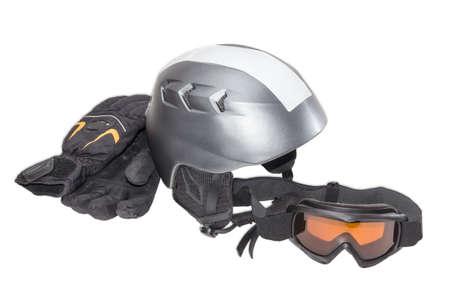 ski goggles: Gray protective ski helmet, ski goggles and black ski glove on a light background