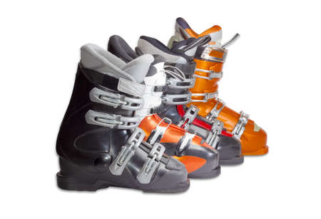 buckles: Several modern alpine ski boots different sizes with four buckles on a light background
