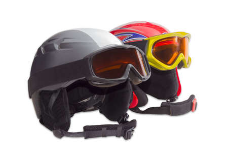 ski goggles: One gray and one red protective ski helmets with ski goggles on a light background