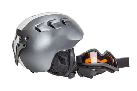 safeness: Gray protective ski helmet and ski goggles on a light background