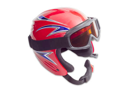 helmet safety: Red protective ski helmet with ski goggles on a light background