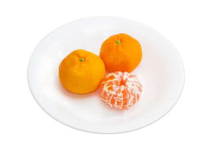 peeled: Two whole and one peeled mandarin orange Stock Photo