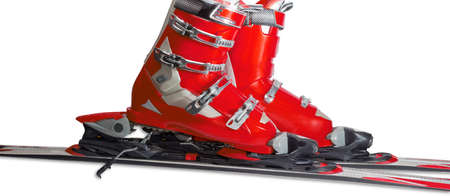 buckles: Red alpine ski boots with four buckles in ski binding. One shoe is completely fastened to the ski, a second just put in binding. Stock Photo