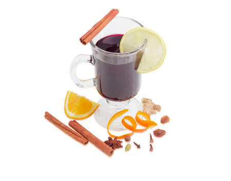 orange peel clove: Mulled wine in glass mug with slice of lemon and cinnamon stick, mulling spices for cooking of a mulled wine on a light background Stock Photo