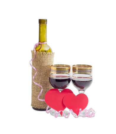 wine glasses: Two wine glasses with red wine, bottle of wine and two hearts made of red paper on a light background