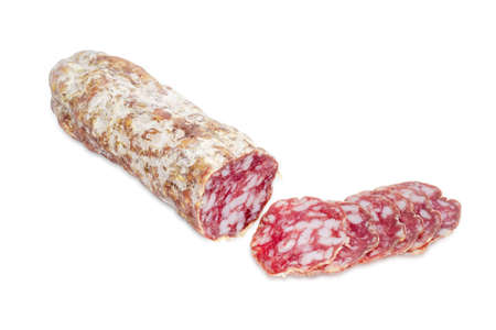 italian salami: Italian salami, partially sliced thin slices on a light background Stock Photo