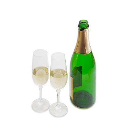 sparkling wine: Two wine glasses with sparkling wine and a bottle of wine on a light background