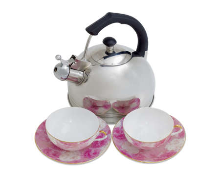 teakettle: Stainless steel kettle with a whistle and two pink porcelain cups with saucers on a light background Stock Photo
