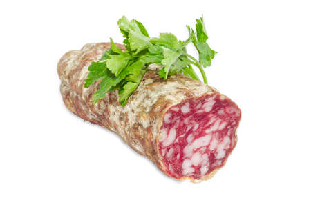 italian salami: Cut italian salami and sprig of parsley  on a light background