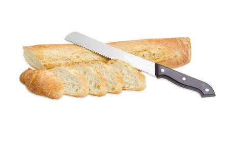 bread knife: Fresh baguette partly sliced and bread knife on a light background