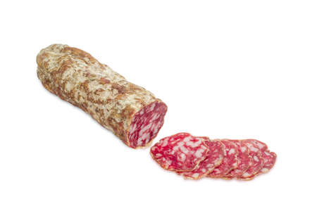 italian salami: Italian salami, partly sliced thin slices on a light background
