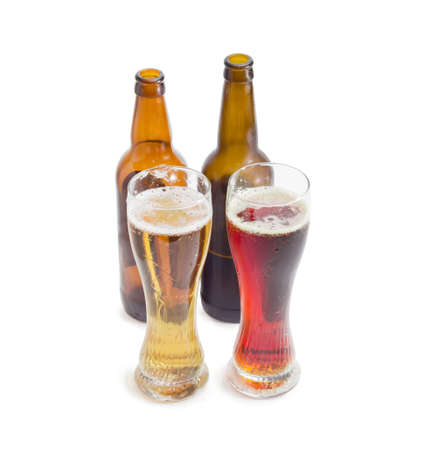 dark beer: Two beer glasses and two bottles with lager beer and dark beer on a light background