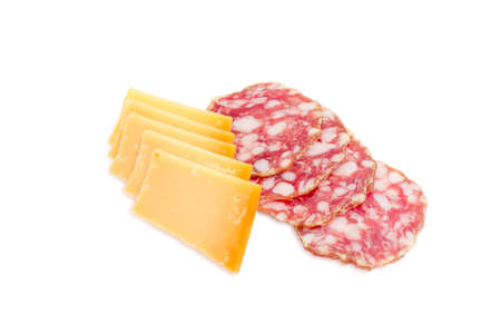 italian salami: Several thin slices of Italian salami and Dutch cheese Beemster on a light background