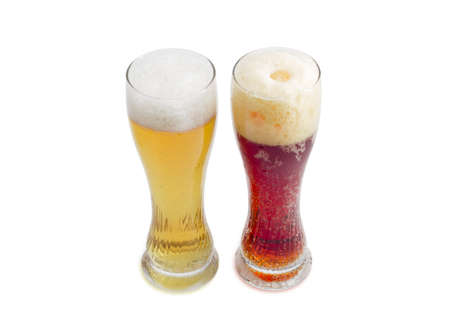 dark beer: One beer glass lager beer and one beer glass dark beer with foam on a light background Stock Photo