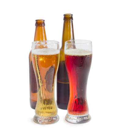 brasserie: Two beer glasses with lager beer and dark beer against of beer bottles on a light background