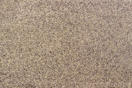 milled: Background of ground black pepper milled coarsely closeup