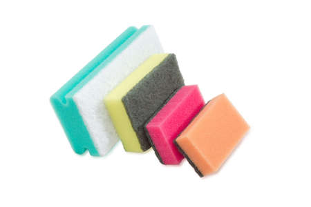 impervious: Several synthetic cleaning sponges with layer for more intense scrubbing different colors and sizes on a light background