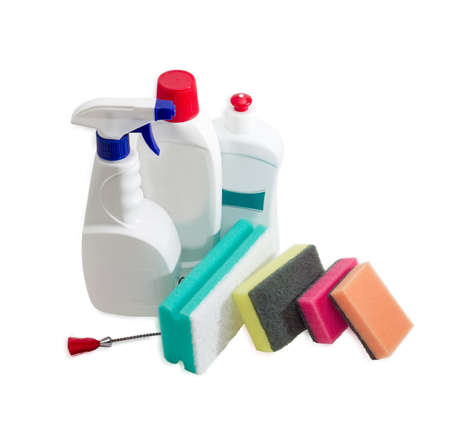impervious: Several synthetic cleaning sponges with layer for more intense scrubbing different colors and sizes, plastic bottles of cleaning agent and spray bottle, dishwashing brush on a light background