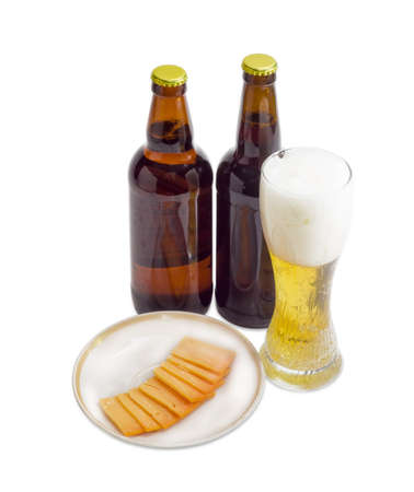 brasserie: Beer glass with lager beer, two bottles beer and several thin slices of hard cheese on saucer on a light background Stock Photo