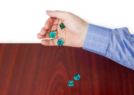 roleplaying: Specialized polyhedral dice with numbers used in role-playing games thrown from male hand on a wooden surface