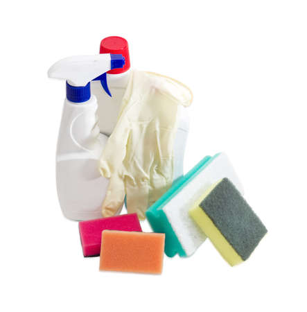 rubber gloves: Several synthetic cleaning sponges with layer for more intense scrubbing different colors and sizes, plastic bottles of cleaning agent and spray bottle, household rubber gloves on a light background