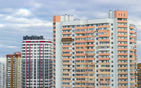 housing estate: Fragment of a housing estate with typical modern multi-storey apartment buildings in a big city cloudy day Stock Photo