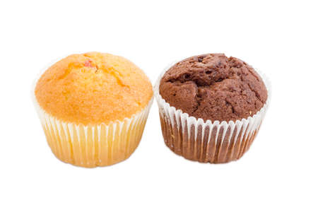 leavening: One sweet muffin with jam and one chocolate muffin in a paper cups on a light background Stock Photo