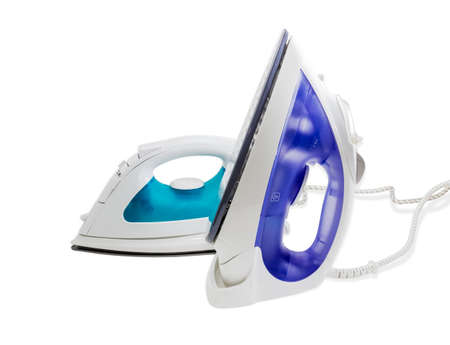 resistive: Two modern electric steam iron on a light background. Isolation.