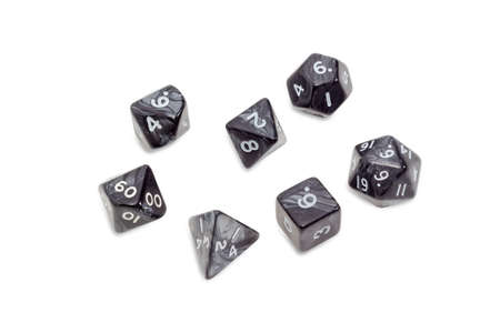 specialized: Set of specialized polyhedral dice with numbers used in role-playing games on a light background Stock Photo