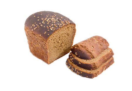 brown bread: Partially sliced loaf of brown bread dusted by coriander seeds closeup on a light background