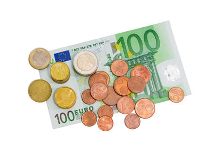 2 50: Several euro coins from 1 to 50 cents and in denominations of 1 and 2 euro on the background of banknote in denomination of 100 euro on a light background