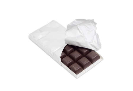 semisweet: Slices of dark chocolate in the opened packaging made of foil on a light background
