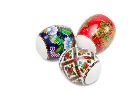 eastertide: Three Easter eggs with a different patterns on a light background