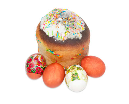 paschal: Easter cake decorated with white icing and colorful sugar decors and several Easter eggs with a various decorating on a light background