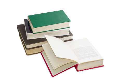 classbook: Open book in the red cover on the background of the stack of other books different formats and cover design on a light background