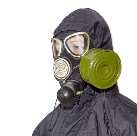 fallout: Head and shoulders of a person in a rubber gas mask with filter mounted on side of the mask and drinking tube and in a black jacket with a hood on a light background