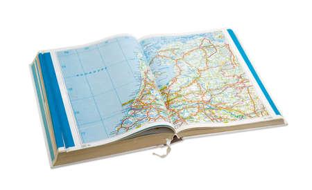 Open old road atlas on a light background Фото со стока