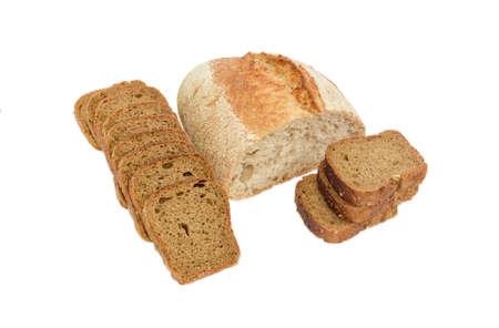 unleavened: Half loaf of wheat unleavened bread with bran and sliced brown bread with whole grain on a light background
