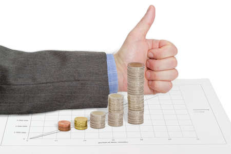 approving: Bar chart, built of euro coins on a line chart on the background of male hand with approving gesture with a raised thumb up Stock Photo
