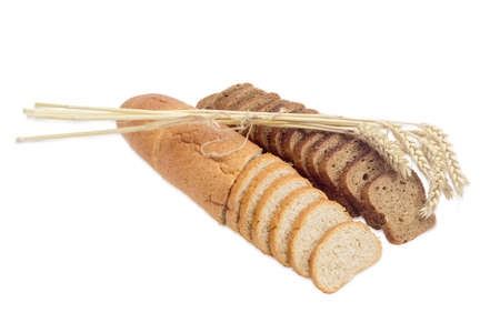 long loaf: One partly sliced long loaf of wheat bread with bran, sliced brown bread with whole grain and bunch of wheat spikes on a light background