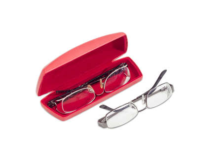 myopia: One modern pair of womens eyeglasses in open red spectacle case and one pair of eyeglasses with metal frame beside on a light background