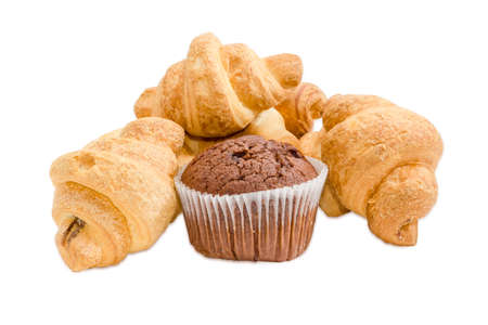 paper cup: Several small croissant and sweet chocolate muffin in a paper cup on a light background