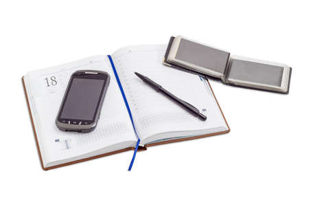 appointment book: Mobile phone and black ballpoint pen on open business diary with blue page-marker ribbon and open wallet with business cards on a light background