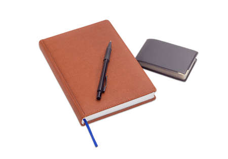 appointment book: Brown business diary with blue page-marker ribbon, black ballpoint pen and wallet with business cards on a light background