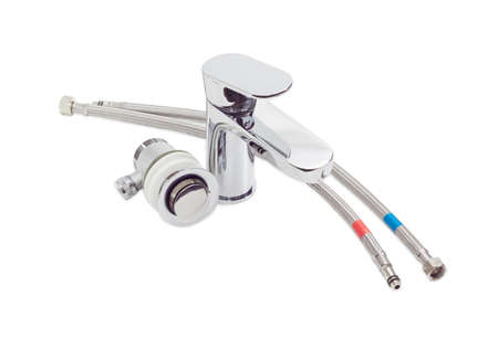 water sanitation: Single handle mixer, drain and two hoses with metal braiding on a light background Stock Photo