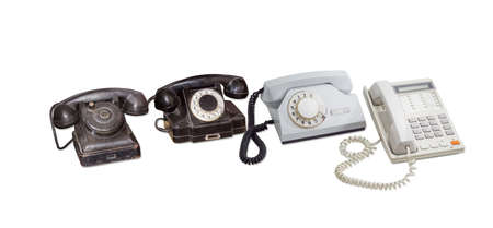 bakelite: Old telephone set without dial, two rotary dial telephone in bakelite and plastic housing and modern landline telephone with push button dial on a light background