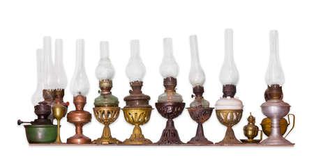 kerosene lamp: Several various old flat wick kerosene lamp on a light background
