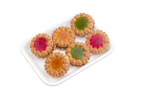 fruit jelly: Biscuit with multi colored fruit jelly on a plastic tray on a light background Stock Photo