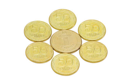 denomination: Coin denomination one Ukrainian hryvnia in the center and around its several coins denomination fifty kopeck on a light background closeup Stock Photo